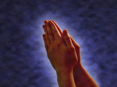 Praying Hands - hands clasped together in...